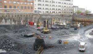 Travaux d'excavation annonçant le début du chantier du Pavillon K de l'HGJ